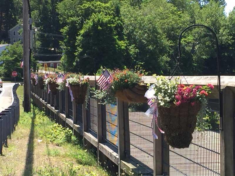 wood bridge with flower pots